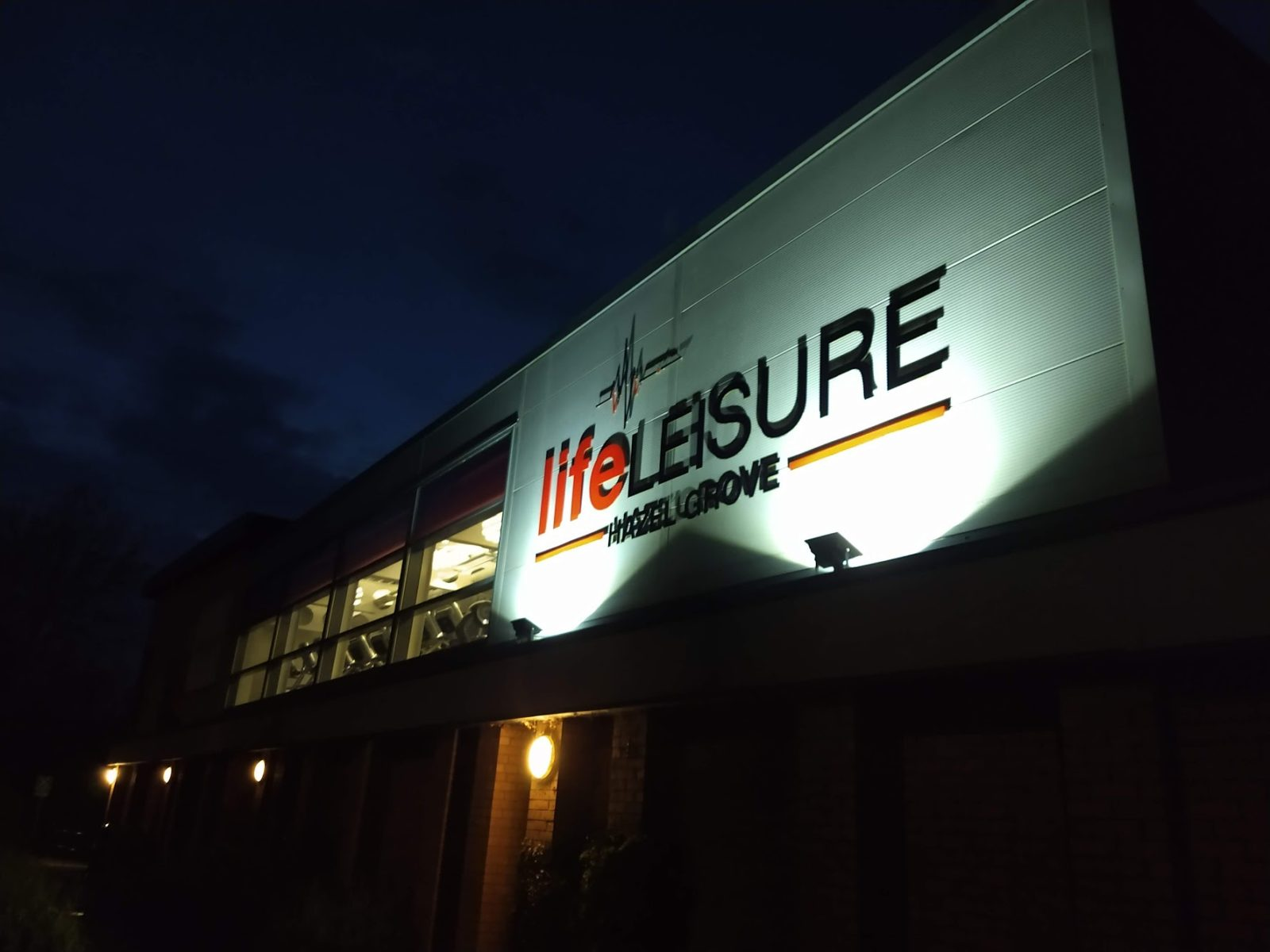 Life Leisure sign lit at night time