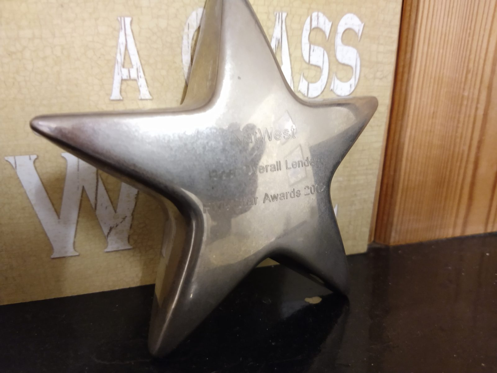 "Star shaped award given to Natwest, engraved with ""Best Overall Lender - Five Star Awards 2002"""