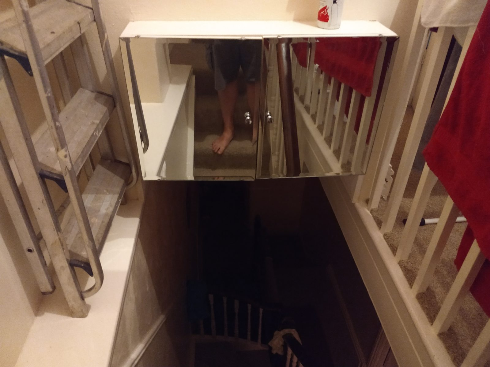 Mirrored bathroom cabinet above the staircase